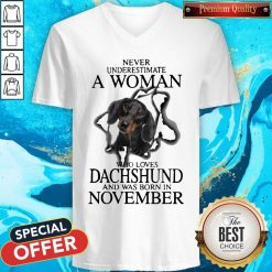 Never Underestimate A Woman Who Loves Dachshund And Was Born In November V-neck